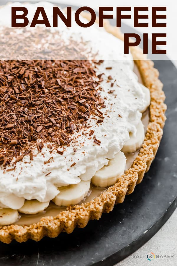 This Banoffee Pie recipe consists of a graham cracker crust, smooth toffee, sliced bananas, and freshly whipped cream. Add a garnish of chocolate curls or chocolate shavings and you have an irresistible dessert! #saltandbaker #banoffeepie #pierecipe