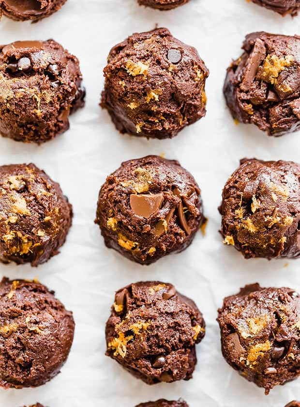 A close up photograph of double chocolate orange cookies in dough balls, prior to baking.