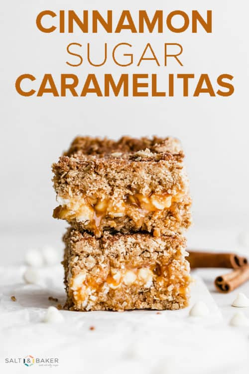Two cinnamon sugar caramelitas stacked on top of each other, with two cinnamon sticks in the background.