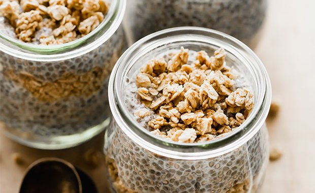 Three glass jars full of Keto chia pudding and topped with granola.