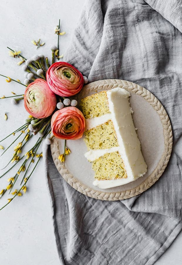 A slice of homemade lemon poppy seed cake on a plate.