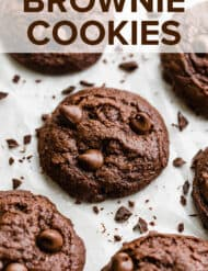 Brownie cookies loaded with chocolate chips surrounded by chocolate shavings.