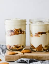 Magnolia Bakery Banana Pudding in a glass jar with layers of Nilla wafers, sliced bananas, and vanilla pudding.