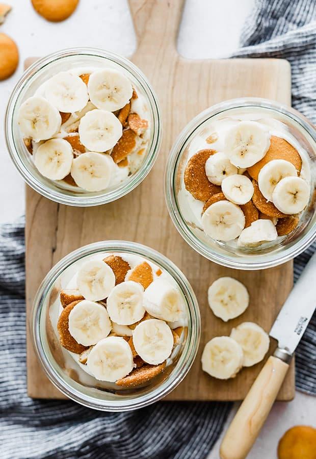Overhead photo of Magnolia Bakery Banana Pudding in glass jars.