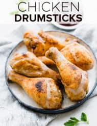 Crispy Baked Chicken Drumsticks on a plate.