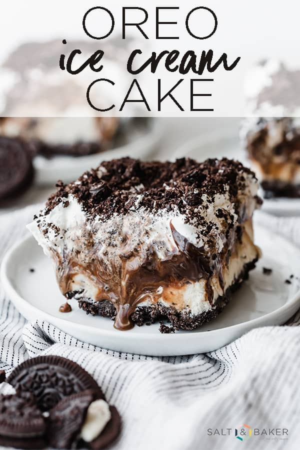 Delicious Oreo Ice Cream Cake on a white plate with hot fudge melting down the sides.