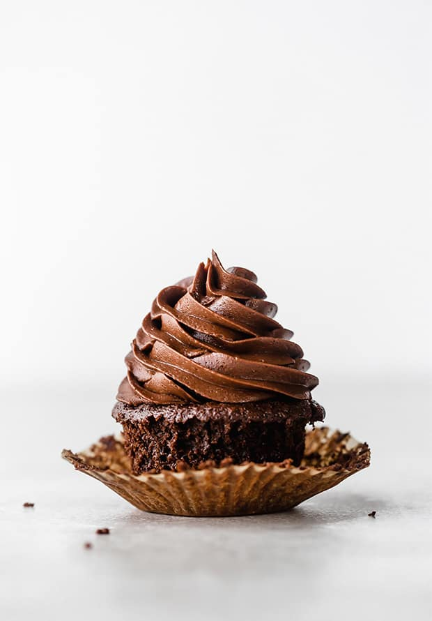 A chocolate cupcake with piped Chocolate Buttercream Frosting.