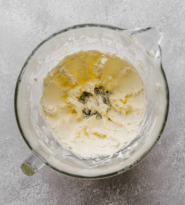 A glass bowl with creamed butter.