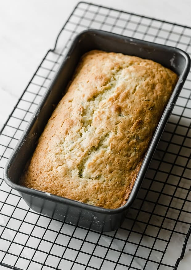 Lemon zucchini bread in a loaf pan right after taking it out of the oven and prior to glazing.