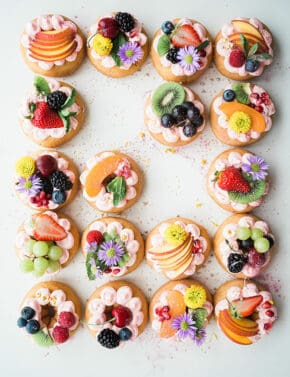 Donuts covered with fruits and flowers.
