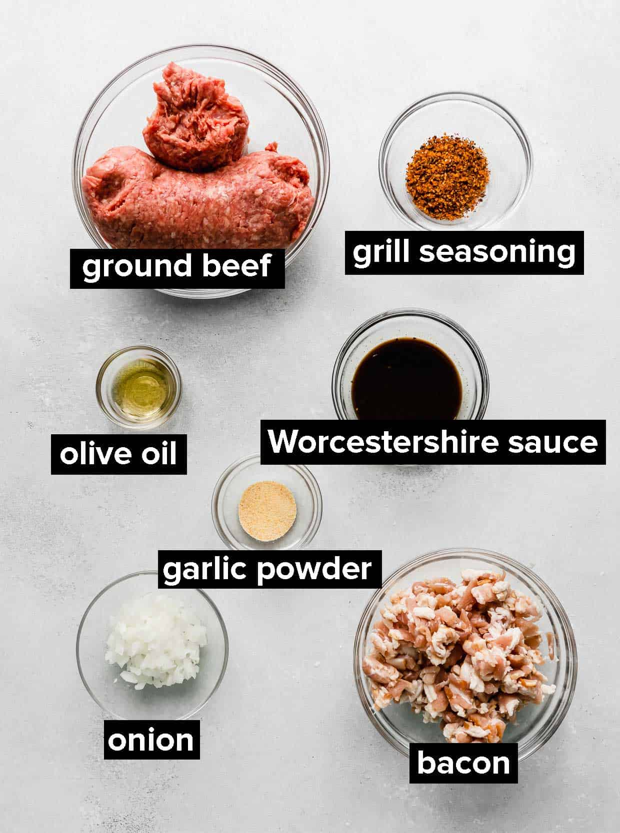 Ingredients used to make the best Bacon Burgers, on a white background.