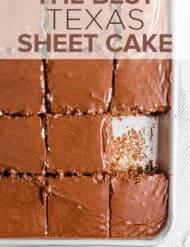 A Texas sheet cake with one serving of cake removed from the pan.