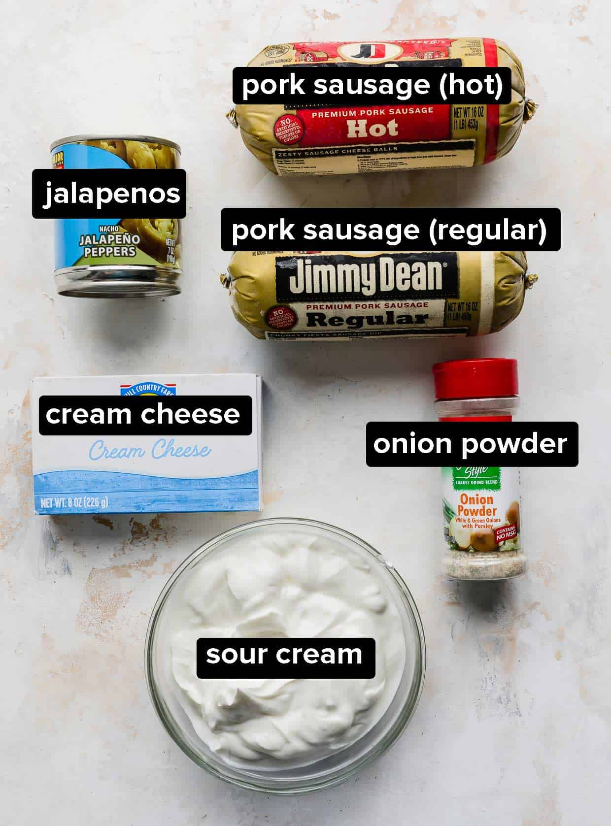 Ingredients used to make cream cheese sausage dip on a white background.