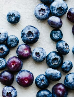 Blueberries scattered on a white background.