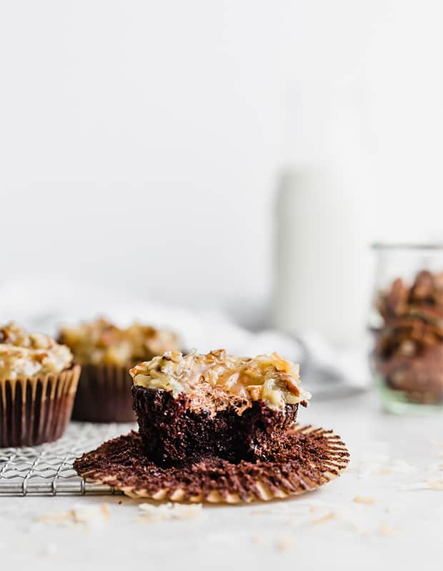 German Chocolate cupcake with a bite taken out of it.