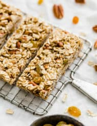 A cooling rack with homemade granola bars on it.