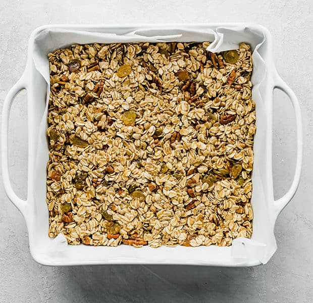 A square pan with homemade granola bars in it.