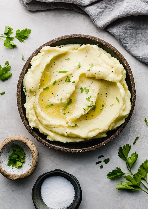 A bowl full of homemade mashed potatoes.