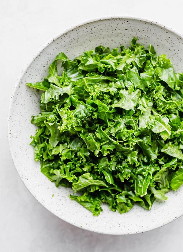 A bowl full of fresh kale.