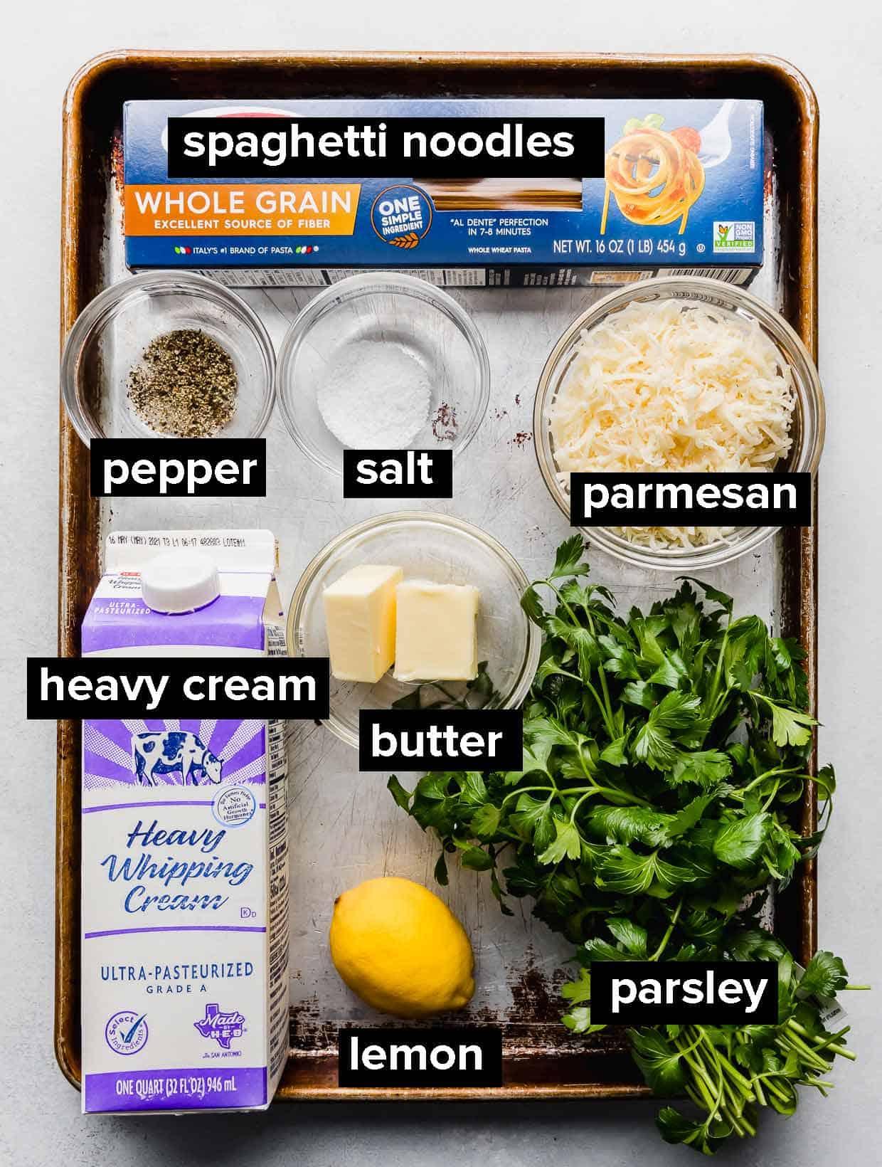 Ingredients used to make lemon pasta on a baking sheet.
