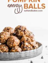 A stack of pumpkin energy balls on a plate.