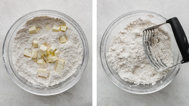 A glass bowl with dry ingredients and cold cubed butter.