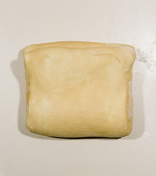 Brioche dough folded into thirds, like a business letter.