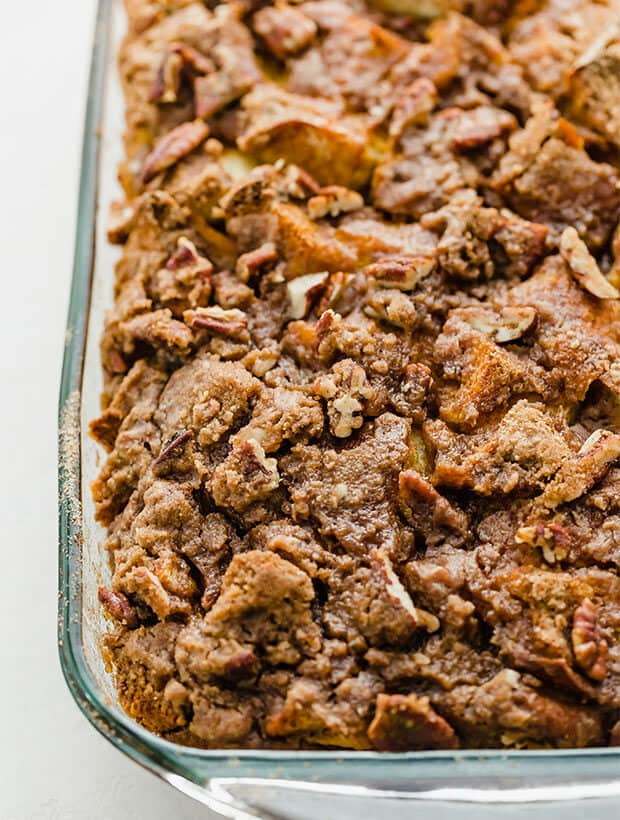 A freshly baked Overnight Pumpkin French Toast Casserole topped with a pecan streusel.