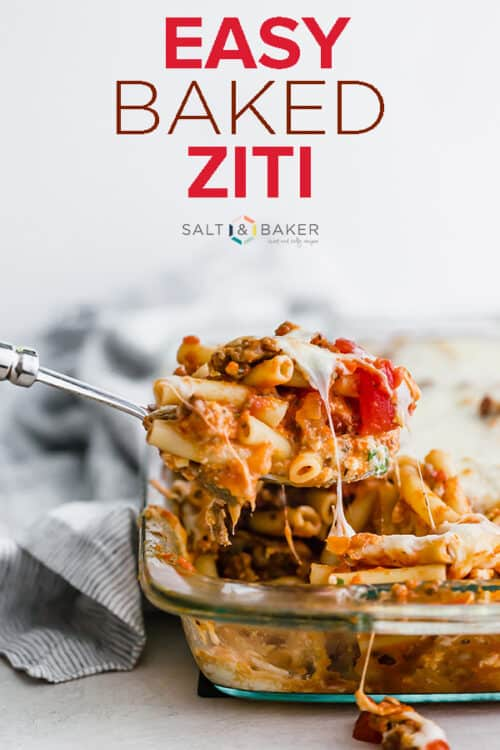 A spoon scooping out some of the baked ziti pasta.