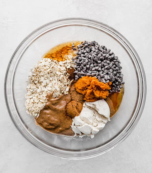 A bowl full of ingredients to make Pumpkin Energy Balls.