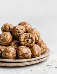 A plate full of Chocolate Peanut Butter Protein Balls.