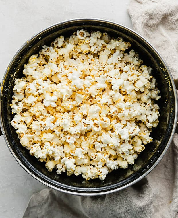 A large pot full of homemade movie theater style popcorn.