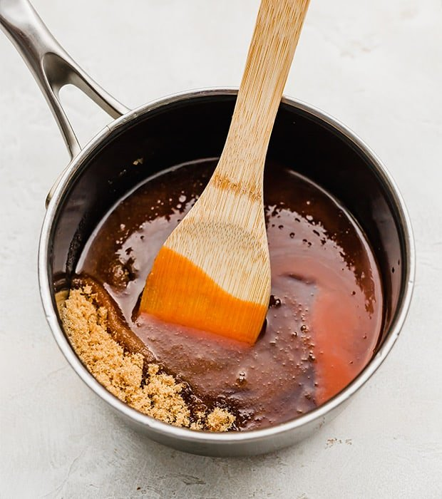 A saucepan full of hot sauce, brown sugar, and a little water.