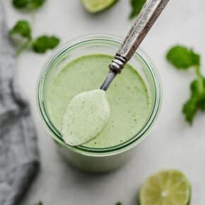 A jar of Cafe Rio's creamy cilantro lime dressing.
