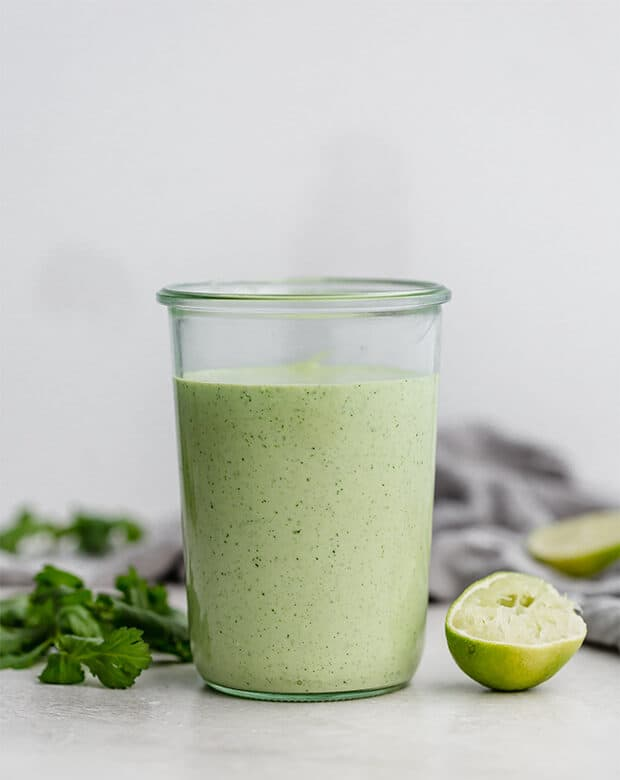 A large jar full of Creamy Cilantro Lime Dressing.