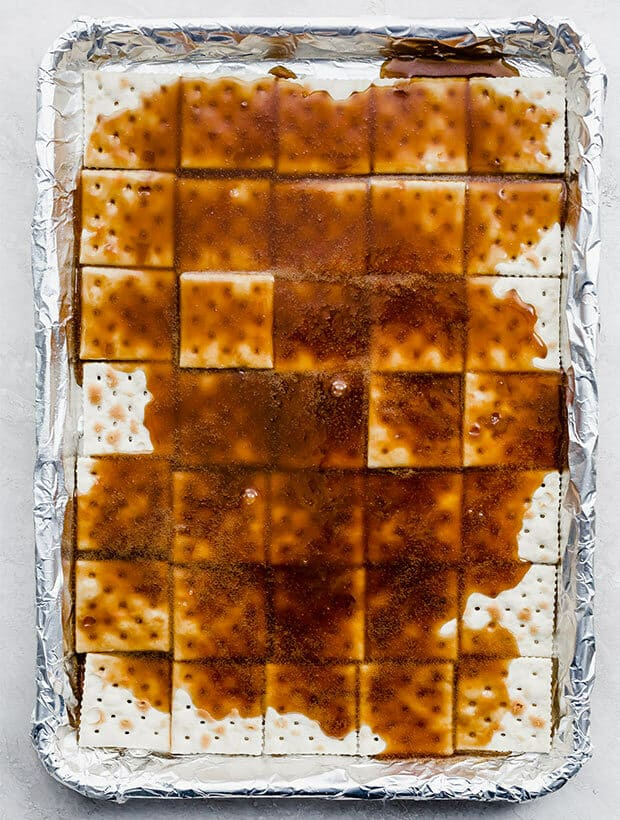 A pan of saltine crackers covered in homemade caramel sauce.