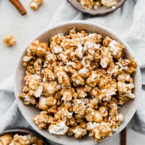 A large bowl full of Cinnamon Roll Popcorn.