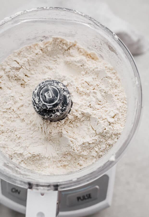 Dry ingredients in a food processor, for making pie crust.