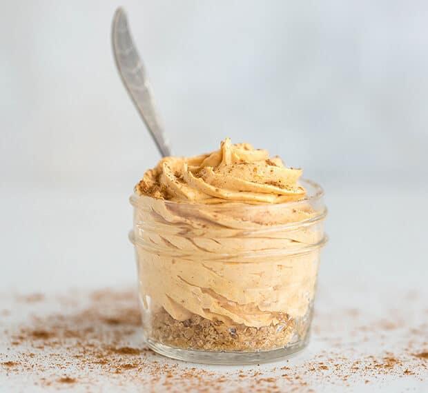No-Bake Mini pumpkin cheesecake in a small glass jar.