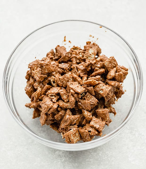 Rice Chex cereal coated in a chocolate peanut butter mixture.