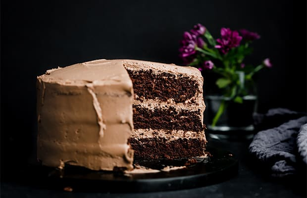 A three layer moist chocolate cake recipe against a black background.