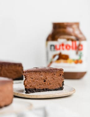 A slice of creamy Nutella Cheesecake on a plate.