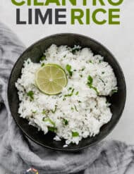 A black bowl full of cilantro lime rice.