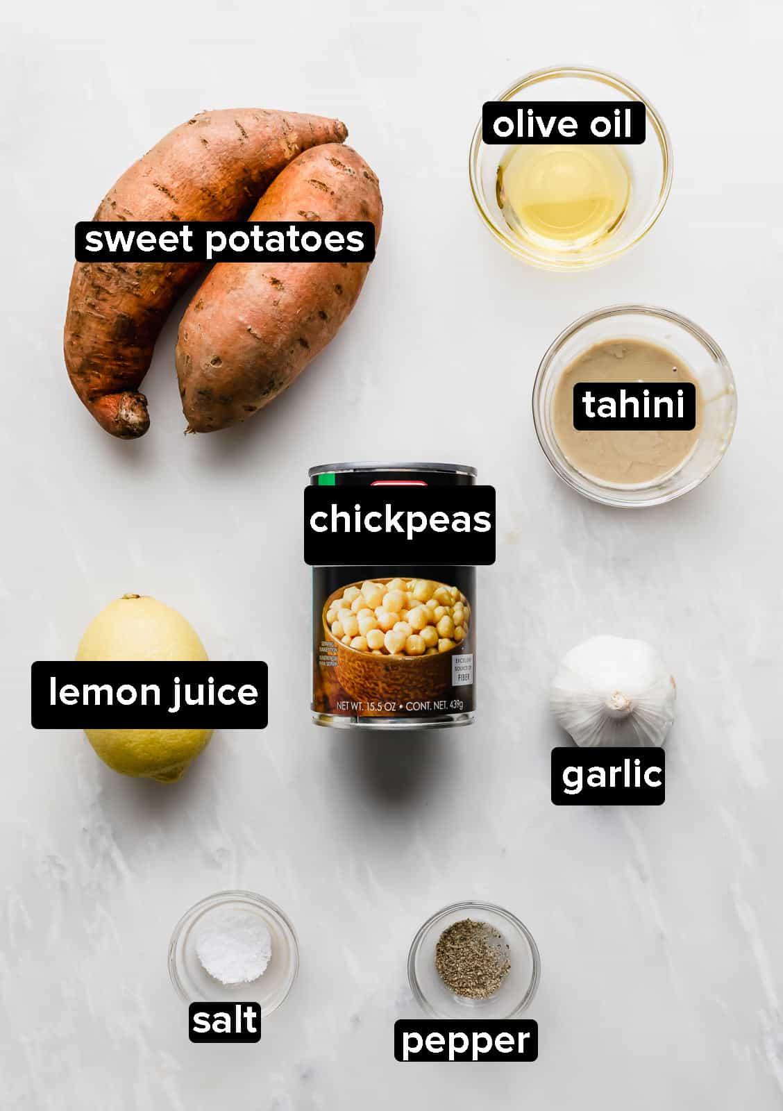 ingredients used to make sweet potato hummus on a white background.