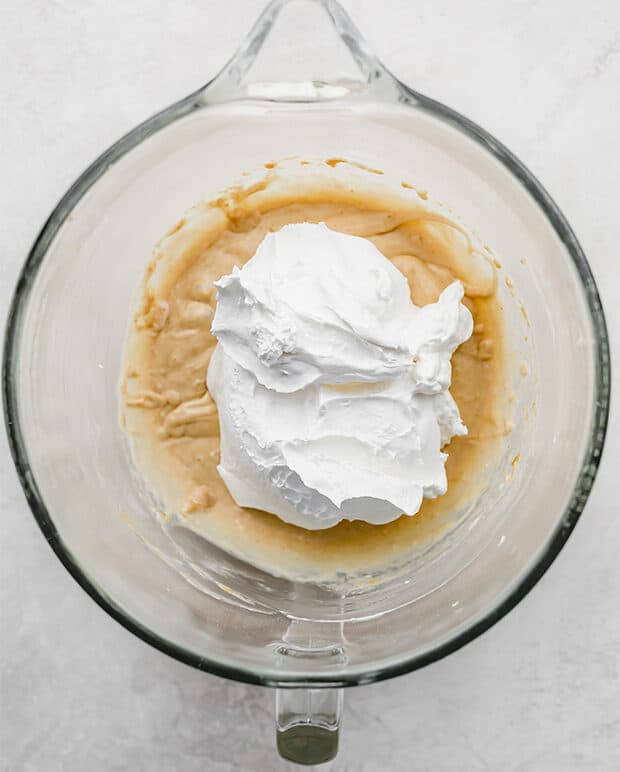 "A large dollop of frozen whipped topping atop the peanut butter pie ""batter."""