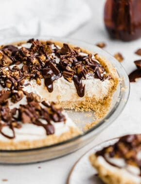 Hot fudge drizzling down the side of a No-Bake Peanut Butter Pie.