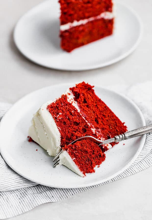 A slice of red velvet cake on a plate.