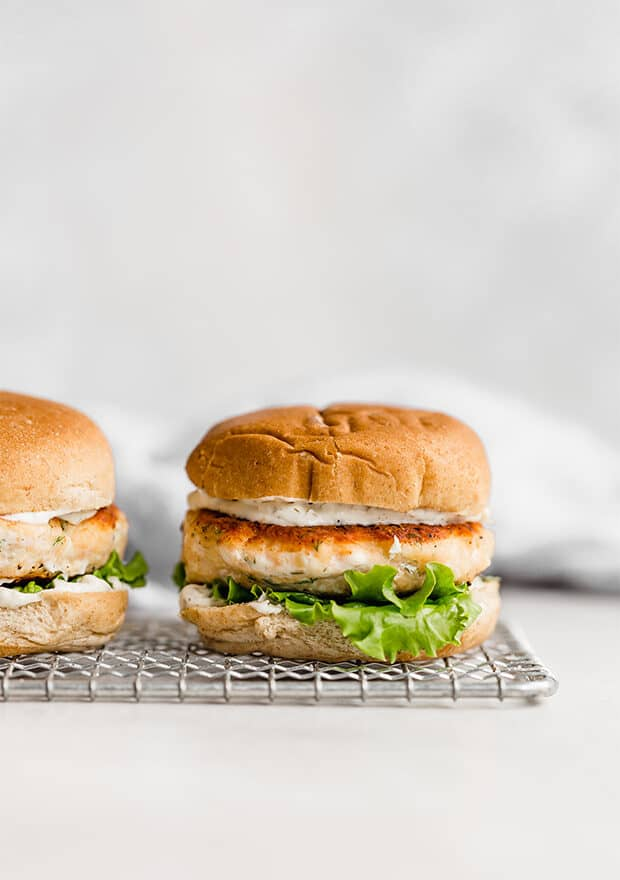 A salmon burger on a hamburger bun.