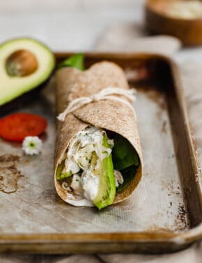 A Healthy Chicken Wrap on a baking sheet, tied up with string.