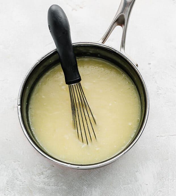 A saucepan full of sauce for acini de Pepe pasta.
